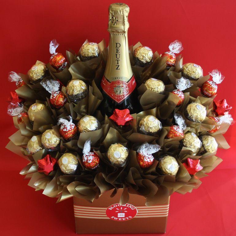 Новогодний букет из шампанского в коробке
